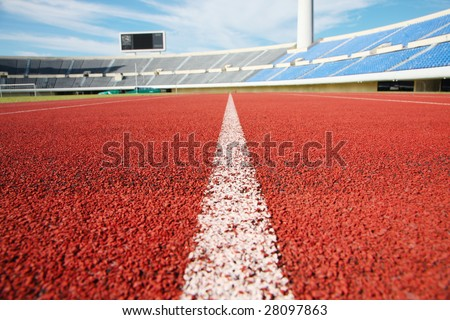 a close up photo of a sports stadium running track - stock photo