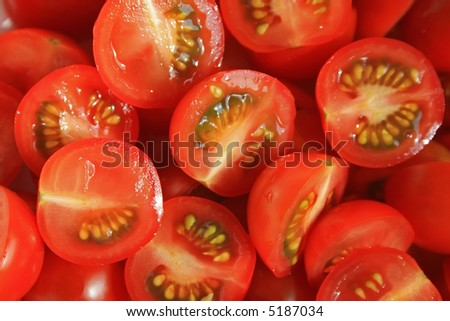 A close-up photo of cutted cherry tomatoes - stock photo
