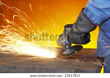 a close up picture of sparks on a grinding wheel - stock photo