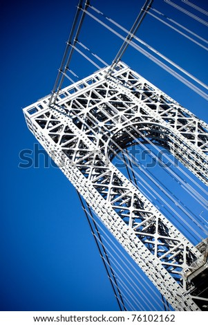 A close up portion of the large gate and metal detail on the New York City George Washington Bridge as seen from below. - stock photo