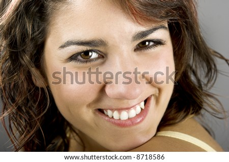 A close-up portrait  of a beautiful young and attractive woman