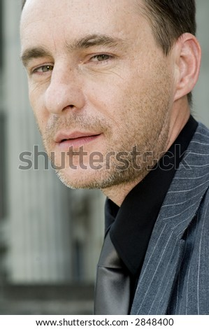 A close-up portrait of a businessman