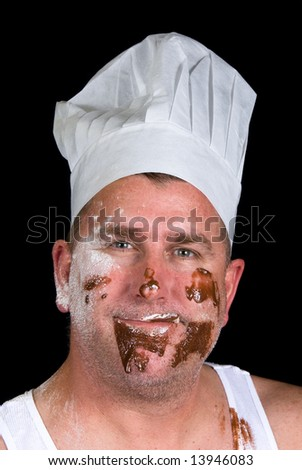 A close up portrait of a cook with sloppy dress and messy cake ingredients. - stock photo
