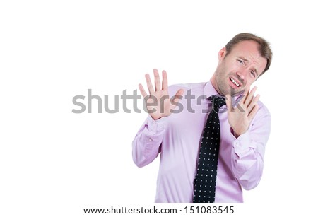 A close-up portrait of a man, businessman, corporate worker, manager, boss gesturing no with hands and saying no with his mouth, denying the situation, isolate on white background copy space on left  - stock photo