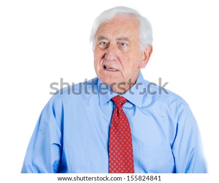 A close-up portrait of a senior unhappy executive, elderly man, grandfather with a very skeptical attitude, isolated on a white background . Human personalities and emotions, conflict resolution. - stock photo