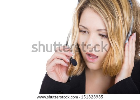A close-up portrait of a telemarketing woman, customer service representative with headset, having a serious conversation with a customer, isolated on a white background - stock photo