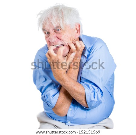 A close-up portrait of an elderly, desperate, mad, crazy looking man, biting his nails, isolated on a white background. Extremes of human emotions. Family loss, elderly loneliness.Geriatric problem - stock photo