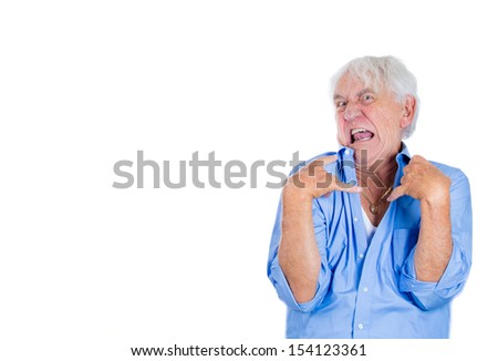 A close-up portrait of an elderly, desperate, mad, looking crazy, desperate man, going insane, isolated on a white background with copy space. Human emotions extremes. Loneliness, grief, family loss.