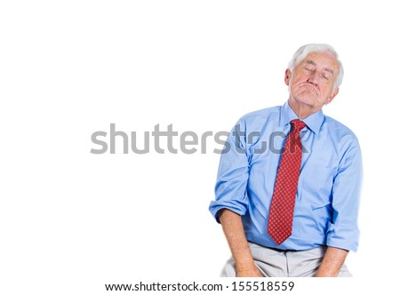 A close-up portrait of an elderly executive, old corporate employee, grandfather in a melancholic mood, daydreaming, taking a nap, isolated on a white background with copy space. Human emotions. - stock photo
