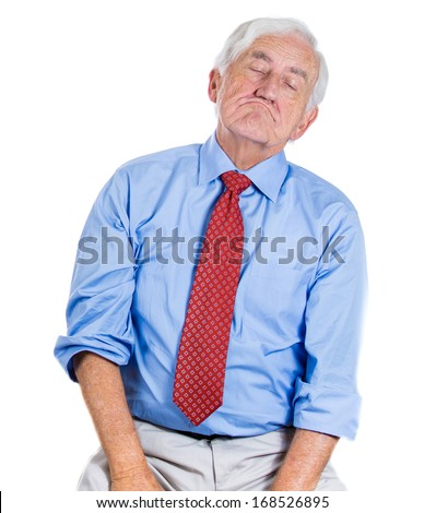 A close-up portrait of an elderly executive, old corporate employee, grandfather in a melancholic mood, daydreaming, taking a nap, isolated on a white background. Human emotions. - stock photo