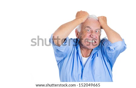 A close-up portrait of an elderly mad, crazy looking, desperate man, pulling out his hair, isolated on a white background with copy space. - stock photo