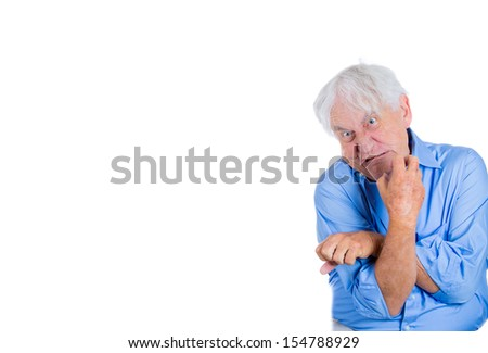 A close-up portrait of an elderly, mad, looking crazy, desperate man, grandfather, going insane, isolated on a white background with copy space. Human emotions extremes. Loneliness, grief, Psychosis.  - stock photo