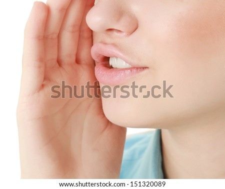 A close-up portrait of whispering woman on white - stock photo