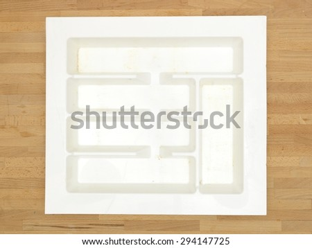 A close up shot a cutlery draw divider - stock photo