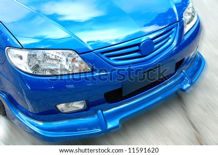 A close up shot (front view) of sportive car - stock photo