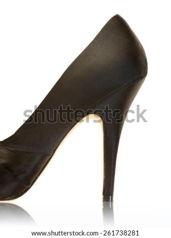 A close up shot of a black high heeled shoe - stock photo