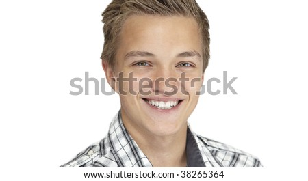 A close-up shot of a boy smiling ,isolated on light white - stock photo