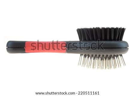 A close up shot of a dogs grooming brush - stock photo