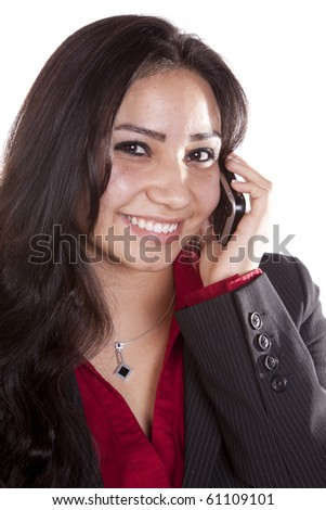A close up shot of a happy woman on her cell phone. - stock photo