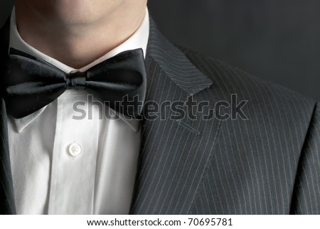 A close-up shot of a man wearing a tux. - stock photo