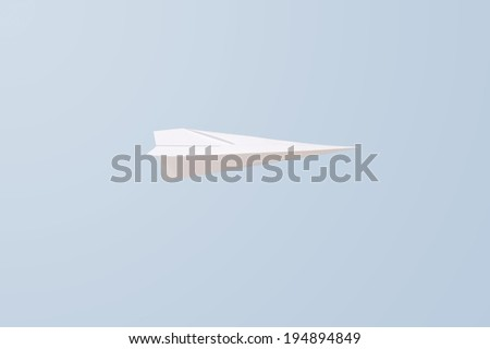 A close up shot of a paper plane - stock photo