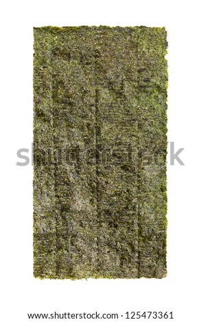 A close-up shot of a sheet of dried seaweed isolated on a white background. - stock photo