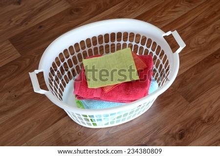 A close up shot of a washing basket - stock photo