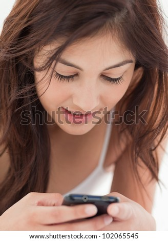 A close up shot of a woman interacting with her smartphone. - stock photo