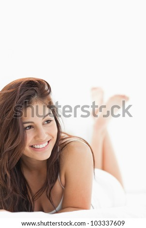 A close up shot of a woman with a smile and crossed legs while looking to the side. - stock photo