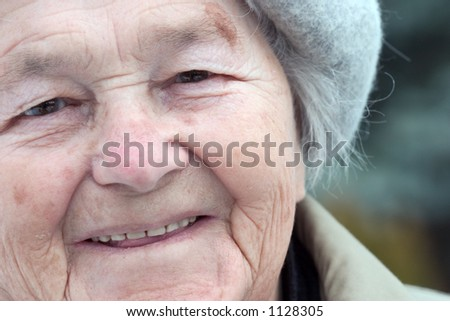 A close-up shot of an elderly woman in her eighties. - stock photo