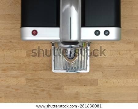 A close up shot of an espresso coffee machine