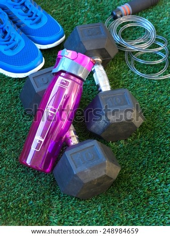 A close up shot of fitness equipment on artificial turf - stock photo