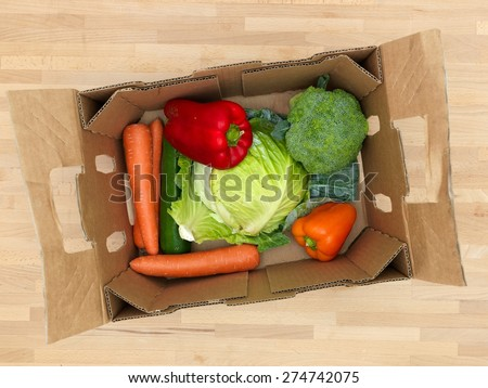 A close up shot of fruit and vegetables in a box - stock photo