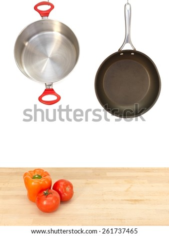 A close up shot of hanging pots and pans - stock photo