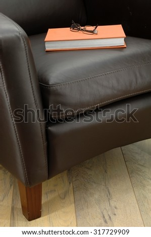 A close up shot of leather arm chair - stock photo