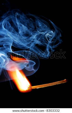 A close-up shot of match ignition with smoke - stock photo