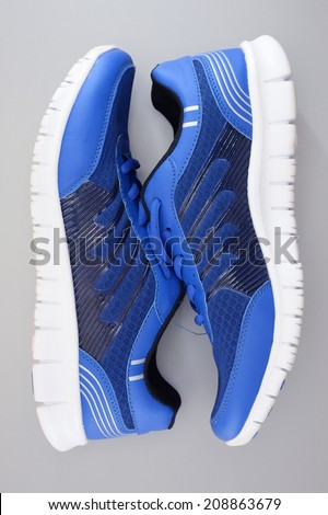 A close up shot of running shoes - stock photo