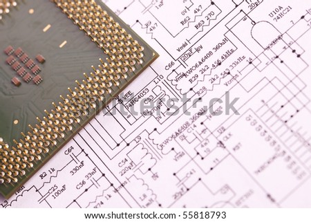 A close up shot of the backside of a computer circuit board, also known as a motherboard.