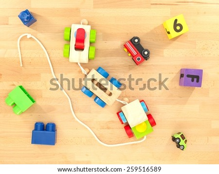 A close up shot of toys scattered over a wooden floor - stock photo