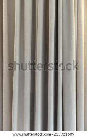 A close up shot of window drapes - stock photo