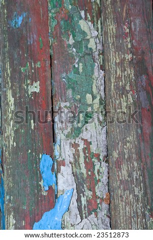 a close up texture of an old painted wooden wall with paint coming off
