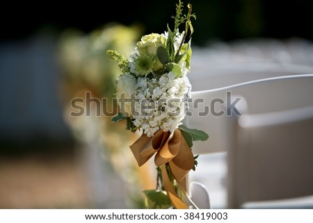 A close up view of a bouquet on a white chair