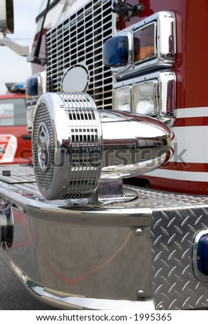 A close up view of a chrome siren on a fire truck - stock photo
