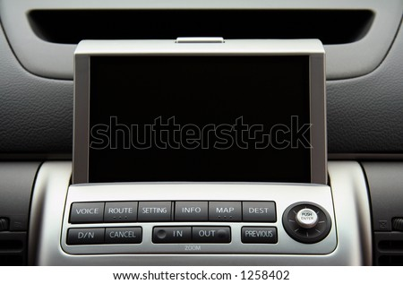 A close-up view of a GPS vehicle navigation system inside a car.  Screen is blank so you can add your own. - stock photo