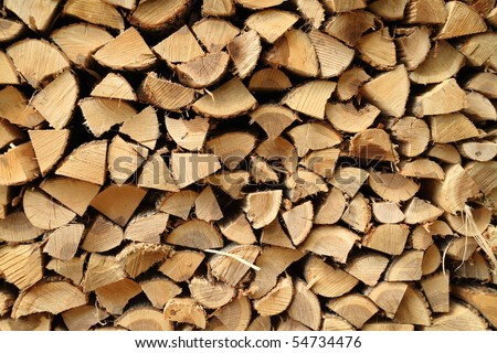 A close up view of a pile of stacked firewood - stock photo