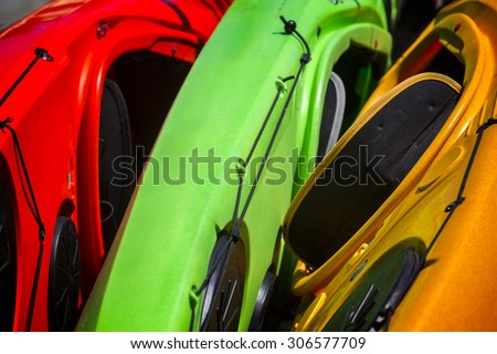 A close up view of a stack of colorful Kayaks in Isle Royale National Park, Michigan, USA. - stock photo