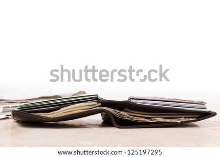 a close up view of a wallet with money and credit cards