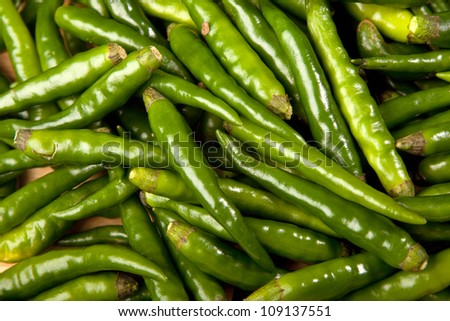 A close up view of green chilli peppers