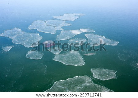 A close up view of large pieces of ice floating in Penobscot Bay in winter. - stock photo