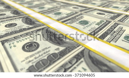 A close-up view of perfectly stacked rows of U.S. dollars bundles - stock photo